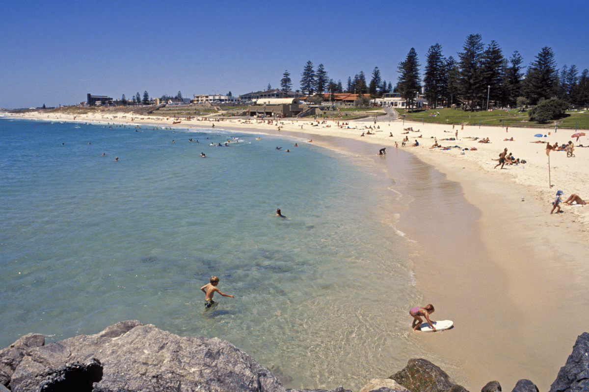 a beach in perth with people and families