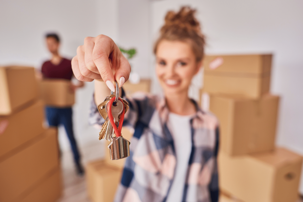 woman with a key to her new home